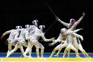 RIO DE JANEIRO, BRAZIL - AUGUST 07:  (Editors Note: Image was created using multiple exposure) Alexander Massialas of the United States defeats Artur Akhmatkhuzin of Russia during Men's Individual Foil Round of 16 on Day 2 of the Rio 2016 Olympic Games at Carioca Arena 3 on August 7, 2016 in Rio de Janeiro, Brazil.  (Photo by Alex Livesey/Getty Images)