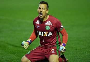 (FILES) This file photo taken on September 28, 2016 shows Brazil's Chapecoense goalkeeper Danilo celebrating after defeating Argentina's Independiente in a penalty shoot-out during their Sudamericana Cup match at the Arena Conda stadium, in Chapeco, Brazil. A plane carrying 81 people, including members of a Brazilian football team, crashed late on November 28, 2016 near the Colombian city of Medellin, officials said. The survivors, two crew members and three players of Chapecoense Real Alan Ruschel, goalkeeper Danilo and Jackson Follman were transferred to local hospitals, according to radio Caracol. / AFP PHOTO / NELSON ALMEIDA