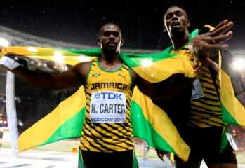 MOSCOW, RUSSIA - AUGUST 11:  Gold medalist Usain Bolt of Jamaica poses with bronze medalist Nesta Carter of Jamaica after the Men's 100 metres Final during Day Two of the 14th IAAF World Athletics Championships Moscow 2013 at Luzhniki Stadium on August 11, 2013 in Moscow, Russia.  (Photo by Jamie Squire/Getty Images)