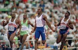 British track and field athlete Linford Christie (3rd from left) of the Great Britain team crosses the finish line in first place to win the gold medal in the final of the Men's 100 metres event at the 1992 Summer Olympics inside the Estadi Olimpic de Montjuic in Barcelona, Spain on 1st August 1992. Other athletes competing are, from left, Leroy Burrell of the United States, Davidson Ezinwa of Nigeria and bronze medal winner Dennis Mitchell of the United States (right). (Photo by Bob Thomas/Getty Images)